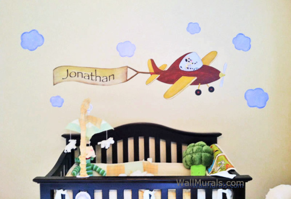 Regular size airplane and banner installed over crib.